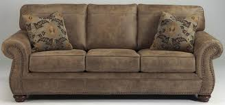 rustic sofas and loveseats traditional style rustic sofa recliner w nailhead trim sam