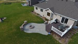 Patio And Firepit by Raised Deck To Patio With Fire Pit And Seat Wall In West Fargo Nd