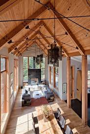 cabin with recycled timbers and a granite fireplace near lake