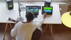 black man creative musician at home studio works by playing