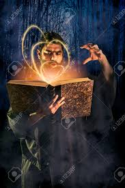 halloween photo book male sorcerer casting a spell from a magical book as halloween
