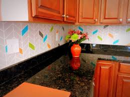13 incredible kitchen backsplash ideas that aren t tile hometalk paint on a colorful chevron pattern