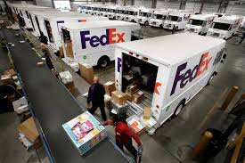 fuel prices fall but fedex and ups boost surcharges wsj