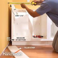 install cabinets like a pro the family handyman how to install base corner kitchen cabinets installing island video