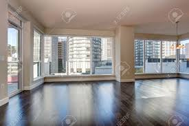 Living Room With Fireplace by Large Empty Living Room With Fireplace And Hardwood Floor Stock