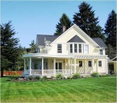 yellow farmhouse wrap around porch home ideas pinterest