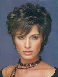 short bob hairstyles for women over 50 ines de la fressange short curly hairstyle with bangs for women