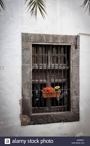 Spanish Colonial House by A Window With A Flower Pot On Spanish Colonial House In Historic