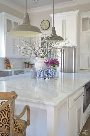 kitchen island decor 3 simple tips for styling your kitchen island white vases carrara