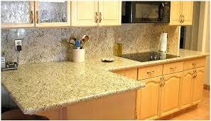 giallo ornamental granite with backsplash crema marfil tile