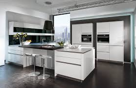 modern open kitchen with white cabinet storage and glass window