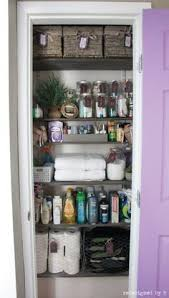 bathroom closet organization ideas large stackable baskets like these large ones on the bottom from