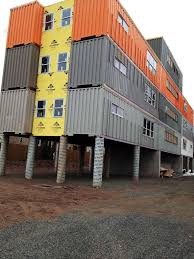 shipping containers stacked to make apartment building in new