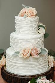 wedding cake icing three tier white line texture wedding cake rustic chic pink