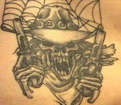 cowboy skull with guns tattoo tattoomagz
