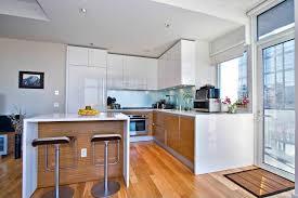 contemporary kitchen with laminate floors u0026 glass panel door