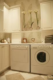 amazing white laundry room design with stacked washing machine and
