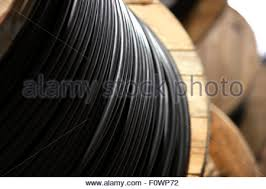 a roll of black electrical cable close up stock photo royalty