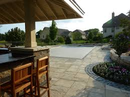 completed inground swimming pools landscaping stone faced pool house and stone flat work