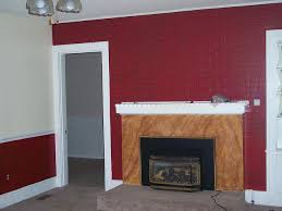 painted over white brick wall and old brown brick fireplace wall