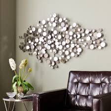Home Sculptures This Upton Home Olivia Mirrored Metal Wall Sculpture Features A