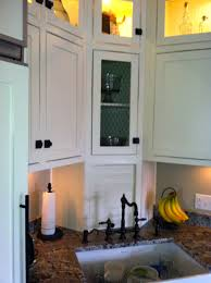 antique white kitchen with face frame inset doors and beadboard