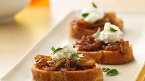 goats cheese canape recipes caramelized and goat cheese crostini recipe bettycrocker com