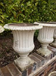 set of 18 matching antique cast iron planters garden plant pots