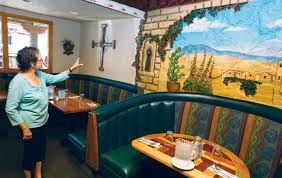 memories on the menu francisco s owner claudine garcia describes a scene in one of the murals at the restaurant artwork and antiques from the family s travels adorn every wall