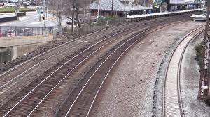 metro north track workers raking in ot