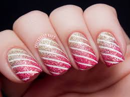 gold and pink glitter nails with white stripes design nail art