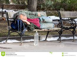 homeless man sleeping on a bench editorial stock image image
