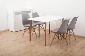 white 120 x 80cm square dining table with 4 grey tulip chairs