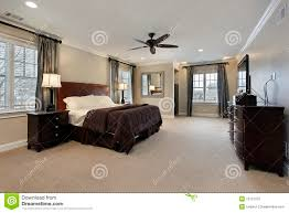 master bedroom with dark wood furniture stock photography image