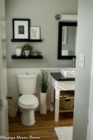 best ideas about floating shelves bathroom pinterest love how they used dark shelving along with mirror frame this color combo looks very fresh serene small master bathroom renovation done thrifty way