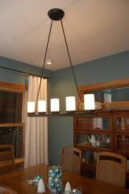 Dining Room Table Light Fixtures In This Stunning Dining Room Three Holly Hunt Light Fixtures Are