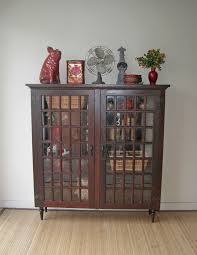 old hutch from farm house converted into a cabinet bookcase hometalk