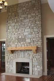 beige fireplace base ideas added by brown wooden mantel shelf on