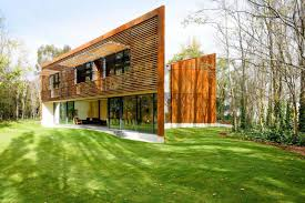 stunning modern house in forest design with wooden wall decor