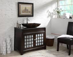 vessel sink bathroom ideas bathroom black woden cabinets with brick wall and black wood chair