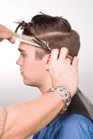 cutting boy hair with scissors scissor over comb
