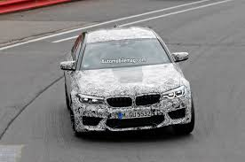 bmw m5 spied with lower front bumper revealed automobile magazine