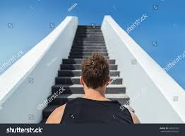 fitness man looking ahead stairs climbing stock photo 644578183