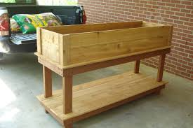 diy standing raised garden planter box using recycled wood with