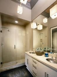 should vanity lights hang over mirror bathroom vanity lights up or down brushed nickel light shower