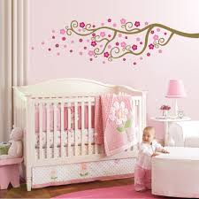 lovely pink baby room design with cute wall tree painting decor