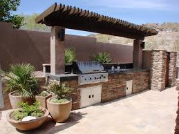 Outdoor Kitchen Lighting Ideas Formidable Grill Summer Kitchen Style With Dashing Hardwood Roof