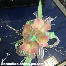 mint green corsage mint green pearl and light pink wrist corsage by beautiful blooms