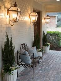 outdoor front porch with metal bench and wall sconces outdoor