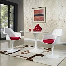 charmingly modern saarinen tulip chairs